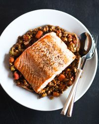 A center-cut salmon fillet is best for roasting because it is uniform in shape and thickness and cooks more evenly than an end piece. Served on a bed of lentils that have been simmered with...