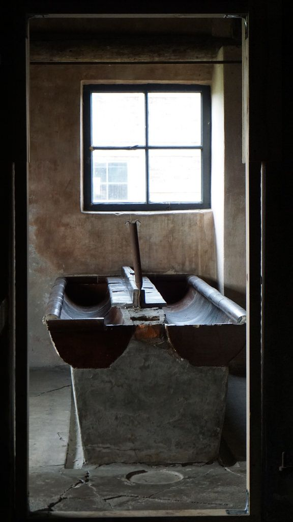 Small washroom for prisoners located in one of the brick barracks.