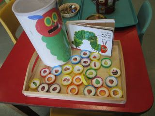 StrongStart: Play Trays ... hungry caterpillar oatmeal canister feed him his food on recycled milk caps ... cute for a birthday party or classroom