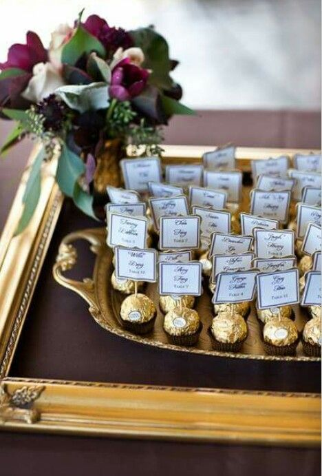 Place settings using Ferrero Roche. Easy and cheap. Could double up as favours.