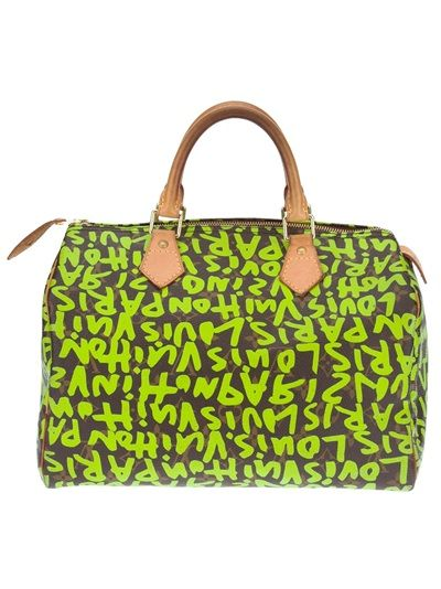 LOUIS VUITTON VINTAGE 'Speedy' Graffiti Tote from A.N.G.E.L.O. VINTAGE PALACE. Brown and green 'Speedy' tote from Louis Vuitton featuring a top zip fastening with a tassel zipper, a gold-tone padlock detail to the side, two contrasting nude short rounded handles to the top with gold-tone hardware, an embellished graffiti print and a twill lining.