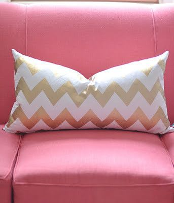 Pair pink with gold chevron for the ultimate chic living room.