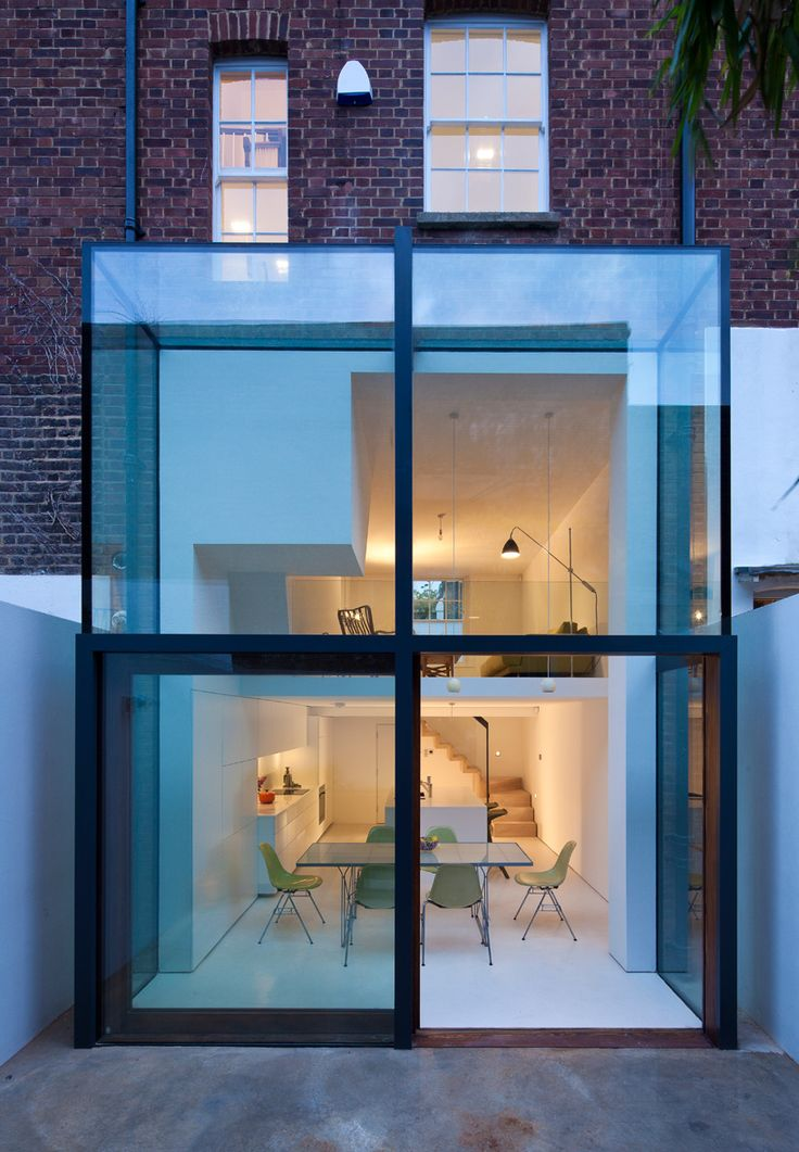 David Mikhail Architects with 'Hoxton House'. Riba Award winner 2011. Minor modernist revision with an extension of just 1m that takes sharp plastering through a glazed facade, against renderless, Victorian masonry.