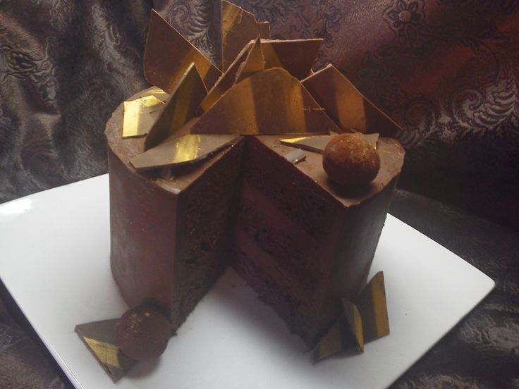 BELGIAN TRUFFLE EMPIRE. An amazing chocolate cake Dessert for any chocolate lover. Delightful Belgian Chocolate Truffle Filling Surrounding Rich and Dense Belgian Chocolate Cake.  Exquisite Belgian Chocolate Pieces and Hand Crafted Truffles Top This Gorgeous Confection