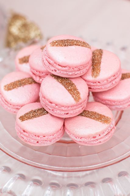 Pretty pink and gold glitter macarons.