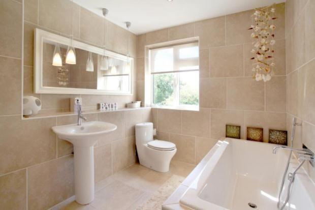 Lush travertine bathroom