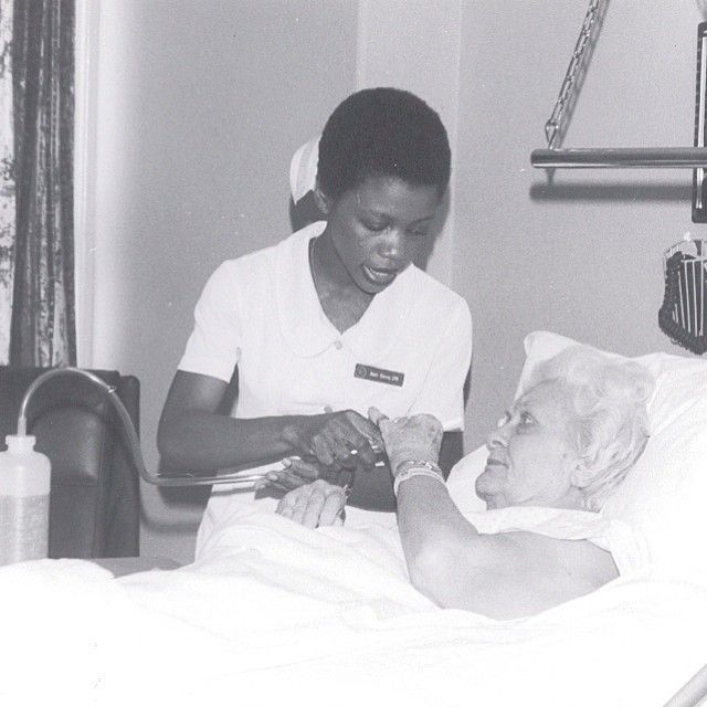 A nurse assists a patient at St. Dominic Hospital.