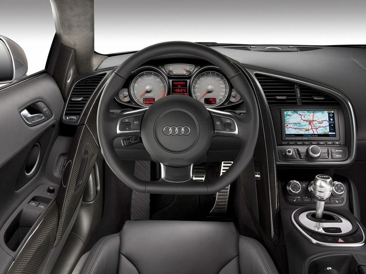 Audi R8----- I've always wanted one. Almost got a silver one couple yrs back but hadda wait to pay off the damn Tahoe first :(