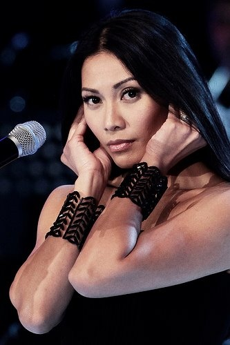 """Anggun.  She left Indonesia in 1994 to pursue an international career. After two years struggling in London and Paris, Anggun met French producer Erick Benzi and signed to Sony Music Entertainment. She released her first international album, Snow on the Sahara (1997), in 33 countries worldwide; this album spawned her international signature hit """"Snow on the Sahara"""", which reached number one in several countries."""