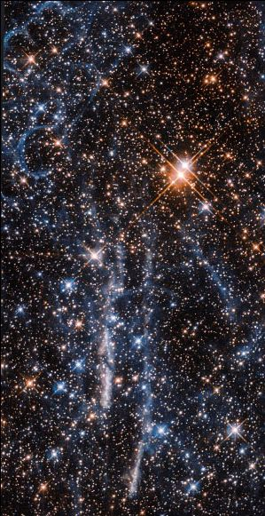 The Large Magellanic Cloud, a satellite galaxy to our own Milky Way Galaxy, is home to one of the largest and most intense regions of star formation known to exist anywhere in our galactic neighborhood — the Tarantula Nebula. This image from the NASA/ESA Hubble Space Telescope shows both the spindly, spidery filaments of gas that inspired the region's name, and the intriguing structure of stacked 'bubbles' that forms the so-called Honeycomb Nebula.