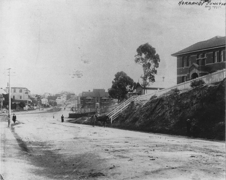 Normanby Junction, Brisbane, ca. 1898 - Street scene at Normanby Junction, ca. 1898. Pedestrians and a horse and cart can be seen on the unsealed road.