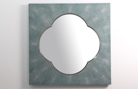 Our Ely wall mirror in teal is a modern design based on quatrefoil pattern. Exclusive to Forwood Design this wall mirror works well as a console table mirror, hall mirror or living room mirror. Framed in stainless steel and blue / green faux shagreen the textured mirror is ideal for modern home interior design.