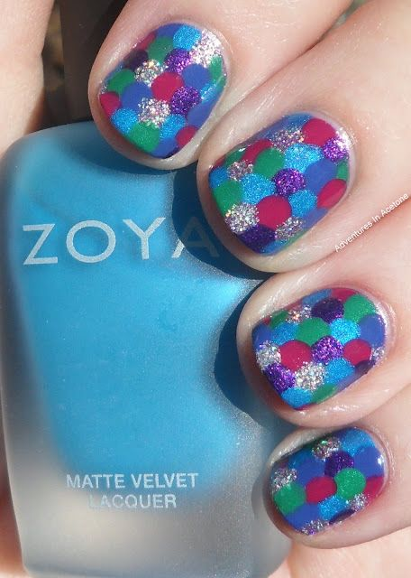 "This is from Adventures In Acetone. It's supposed to be Rainbow Fish Nails but I like it because the ""scales"" actually look to me like a patchwork quilt (my mom's a quilter). Also the background design of this website is the Double Wedding Ring quilt design."