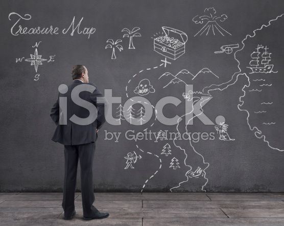 Businessman with Treasure Map Sketched on the Wall (royalty-free stock photo) © mgkaya