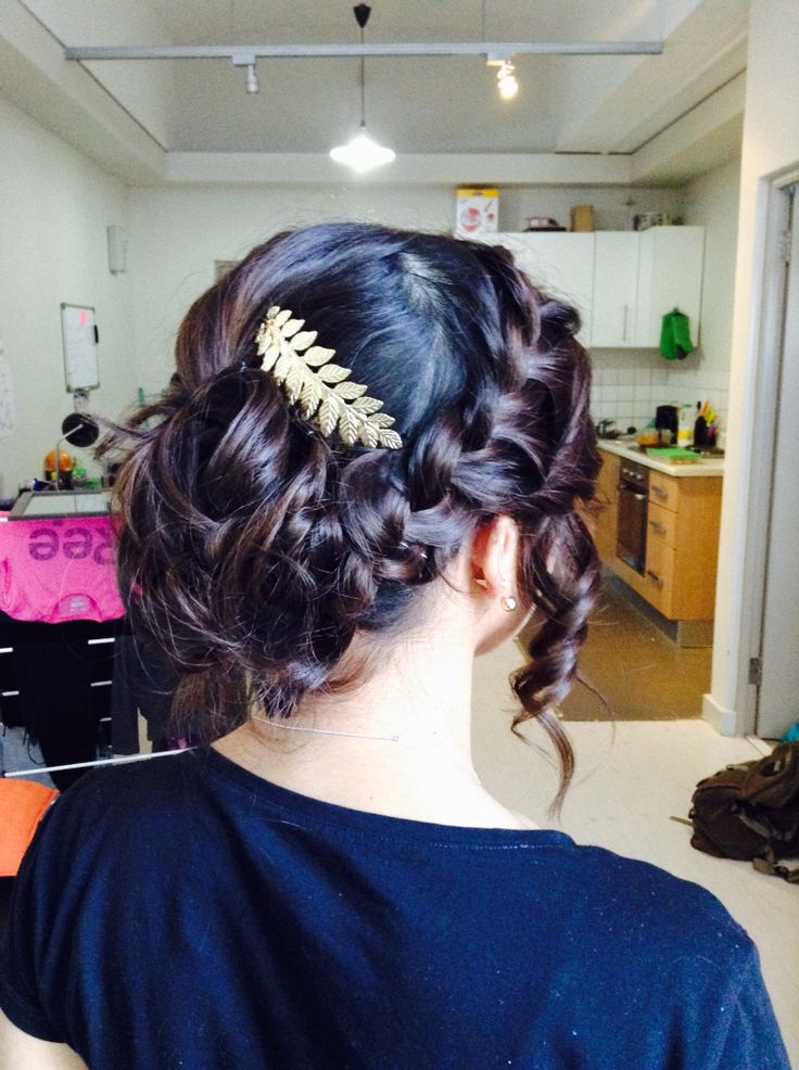 Curly up-do with a side French braid and gold hair piece.  -Zakiyah Bhadella