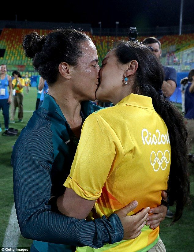 The kiss beamed around the world: Brazillian rugby player Isadora Cerullo locks lips with her new fiancee, the Olympic worker Marjorie Enya