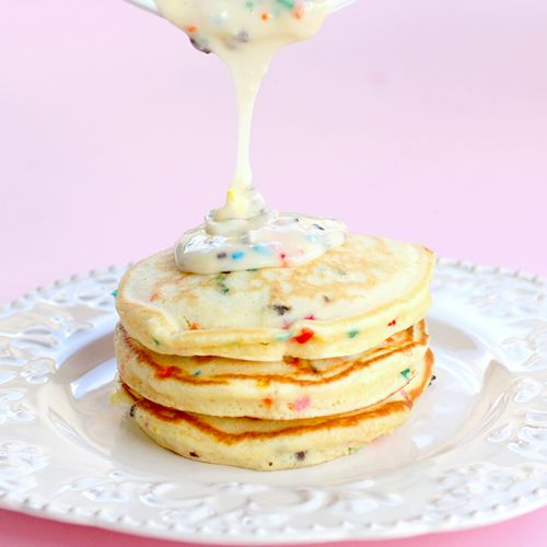 Cake batter pancakes! Great to wake up to on your birthday! Or really any other day that needs to start out with a treat masquerading as breakfast.