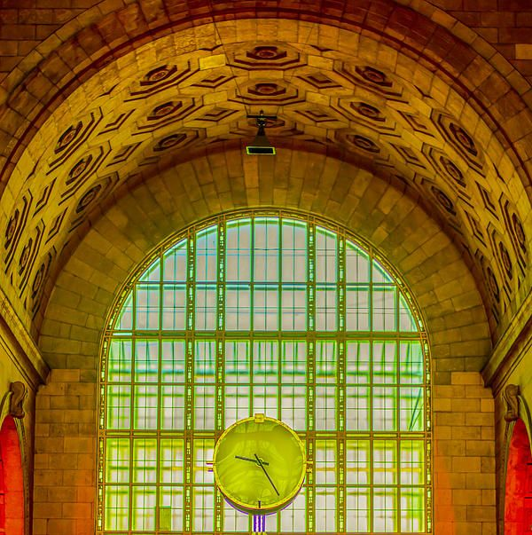 Ornate architecture adorns the entrance into Union Station in Toronto, Canada, with its stained glass window and large clock in the centre.