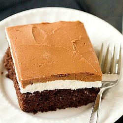 A recipe for Ho Ho Cake - chocolate cake, a fluffy white filling and a rich chocolate frosting.