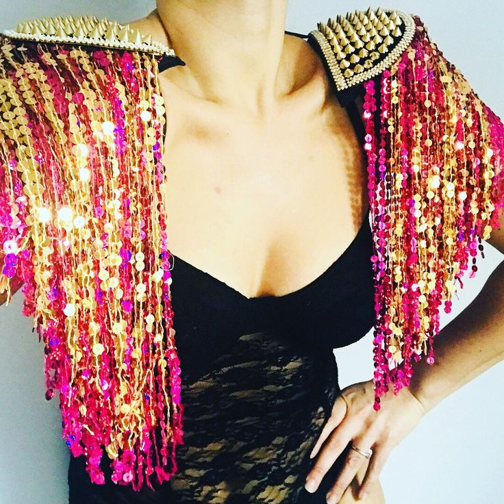 Brand new vibes. Fabulously sparkly gold and pink sequin tassel studded and diamanté trimmed epaulettes. The perfect accessory to get your festival wardrobe off to a flying start.