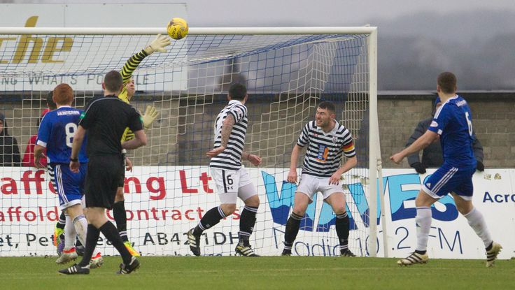 Queen's Park's Wullie Muit pushes the ball over the bar during the Ladbrokes League One game between Peterhead and Queen's Park