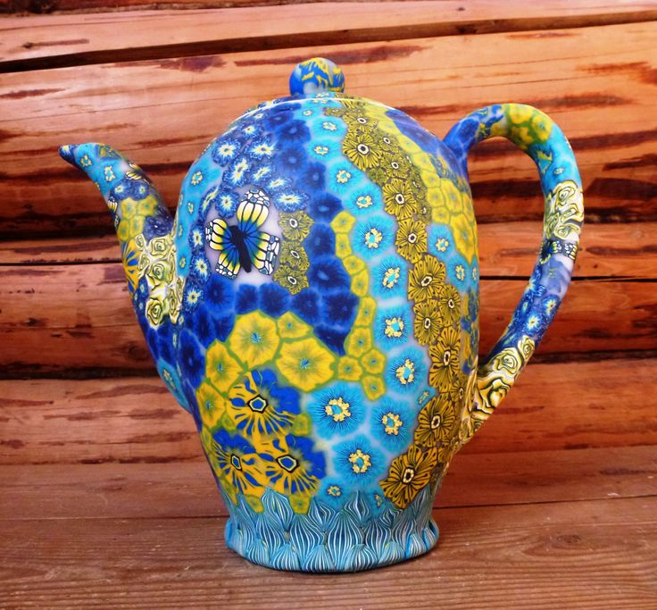 Coffee or chocolate pot made from polymer clay on porcelain