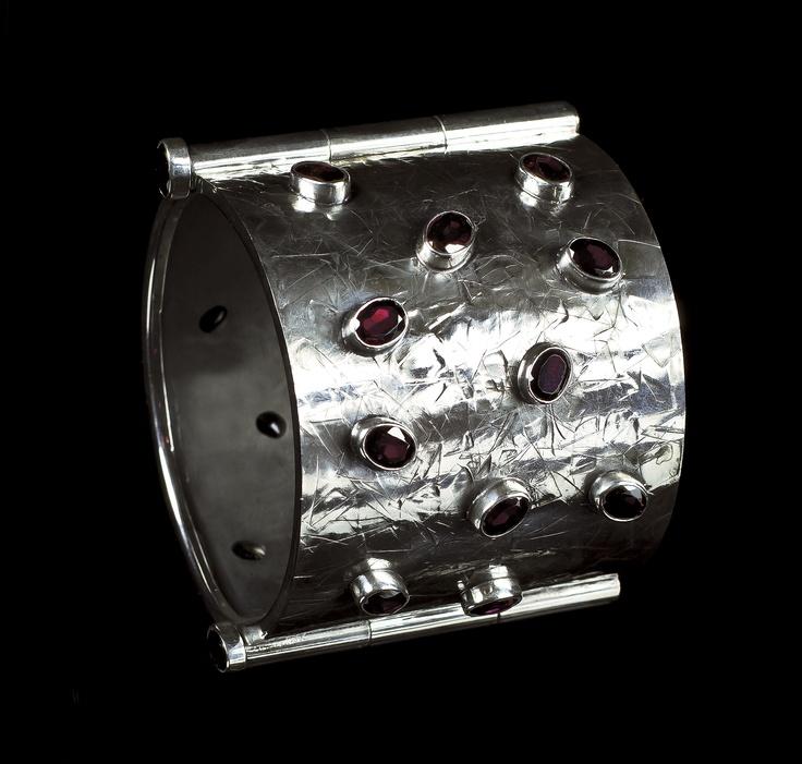 Bracelet by Horsecka Jewelry.  Oxidized sterling silver, garnets. #jewelry #jewellery #horsecka #annahorsecka