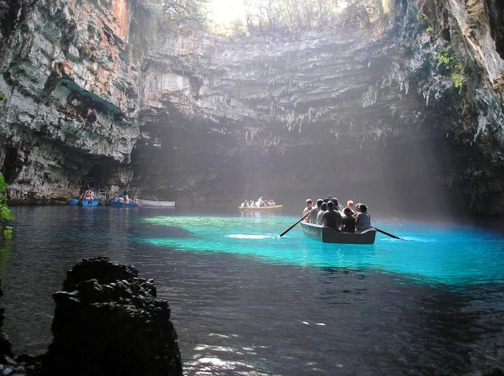 Melissani Caves, kefalonia/Cephalonia, Greece - Forests surrounds the cave and the mountain slope is to the west. Near the cave is the entry to the cave with parking lots and is passed almost in the middle of the main road linking Sami and Agia Efimia especially to the northern part of the island.In Greek mythology, Melissani was the cave of the nymphs. #Greece #Caves #Lakes