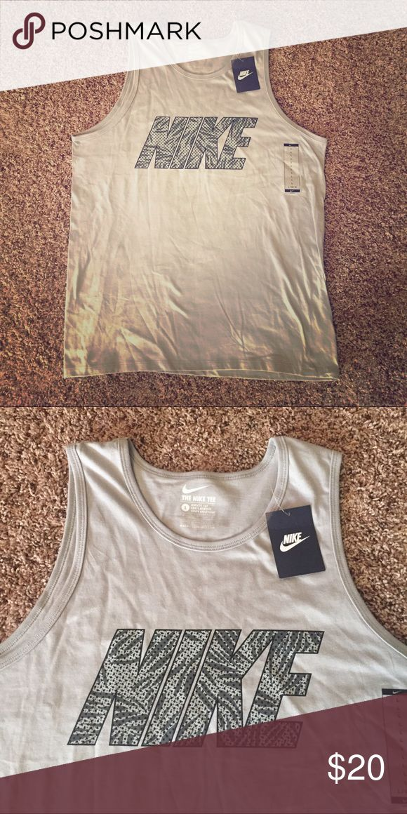 Men's Nike Tank Black and grey nike tank top for men. Bundle with other Nike tanks in my closet for an amazing deal! Nike Shirts Tank Tops