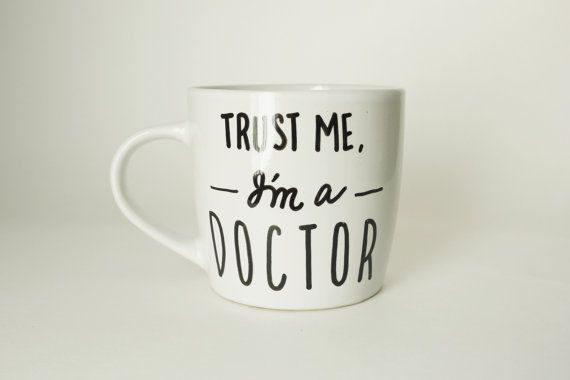TRUST ME IM A DOCTOR MUG This coffee mug would make a unique and useful gift for any PHD student, graduate, or professional doctor! The mugs 11 oz.