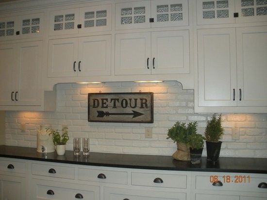 "Faux brick veneer painted high gloss for that ""subway tile"" look."
