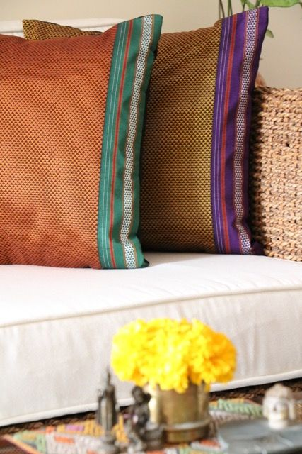 A riot of colourful cushion covers by Omnah, in rich jewel tones and contrasting borders of the traditional handloom 'Khunn' fabric now available to buy via Jaypore.com.