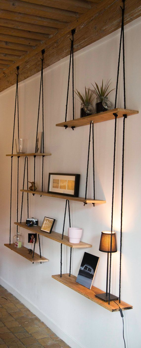 Shelves suspended in solid oak and hemp rope. Dimensions to measure. The presented shelf measuring 2.50 metres wide, 2,50 high and 20cm depth.  Do not hesitate to ask for different size.