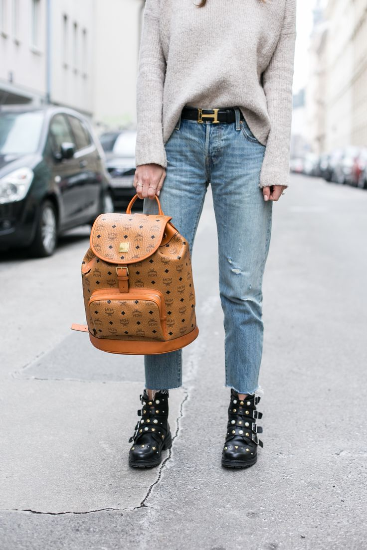 MCM Heritage Backpack, Levis 501 CT Jeans, Kurt Geiger Boots Update your off-duty ensembles by adding stylish Swish to the mix. The latest ankle boot from Carvela Kurt Geiger, this essential season silhouette gets the biker boot treatment with four distinctive buckle straps, complete with gold hardware detailing set upon a flat supportive sole.
