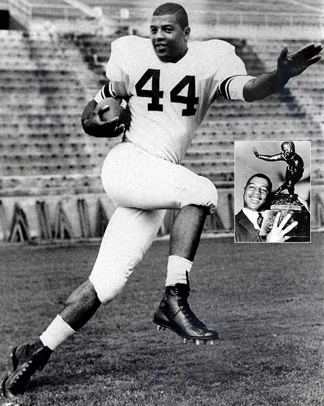 Two years after leading Syracuse to its first and only national championship as a sophomore, Ernie Davis became the first African-American player to win the Heisman Trophy.