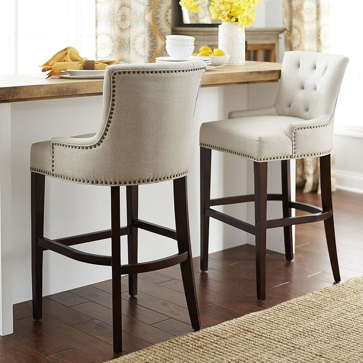 Our Ava stools offer a most elegant perch. Classic tailoring includes a comfortable contoured back with deep button tufting, low-slung swoop armrests, a generous seat and brass nailhead detail.