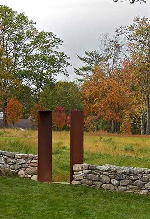 Minimalist rusted corten steel sculpture at Meadow Farm in Wilton, Connecticut by Stephen Stimson Associates