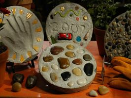 Rock Out A Garden With Memories in Stone : Home Improvement : DIY Network  Something to try to add to my landscaping project.  Would be fun to have each of my grandkids (have 13 of them) make one of these.