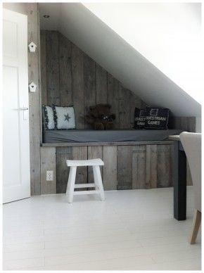 slanted ceiling with bed