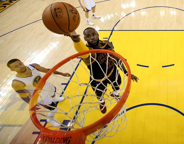 LeBron James Photos Photos - LeBron James #23 of the Cleveland Cavaliers throws up a shot against the Golden State Warriors in Game 1 of the 2017 NBA Finals at ORACLE Arena on June 1, 2017 in Oakland, California. NOTE TO USER: User expressly acknowledges and agrees that, by downloading and or using this photograph, User is consenting to the terms and conditions of the Getty Images License Agreement. - 2017 NBA Finals - Game One