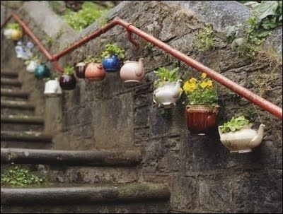 Hanging teapots. What a cute idea.