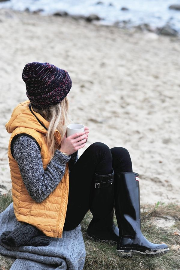 Fall/Winter style for a day exploring on the beach - puffer vest, sweater, and glossy black Hunter boots