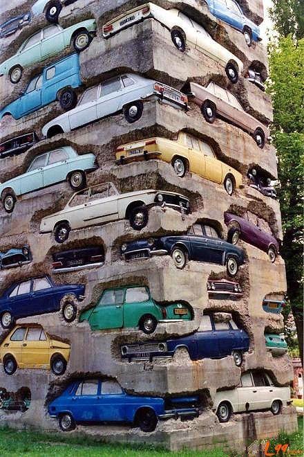 Cars monument  How many cars you recognized? :)  I see: 1) Fiat 125p |  2) Fiat 126p |  3) Lada 2105 |  4) Renault 5 |  5) Zastava 1100 |  6) Austin Mini |  7) Mercedes Benz W111 |  8) BMW M3 |  9) Wartburg 353 |  10) Opel Commodore |