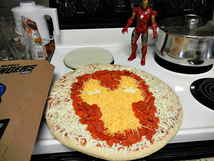 Iron Man pizza--bless this blogger for posting this idea.  I kept her blog post open as I tried to put the pepperoni on the pizza to shape Iron Man's face.  My son still talks about this and he hates pepperoni.