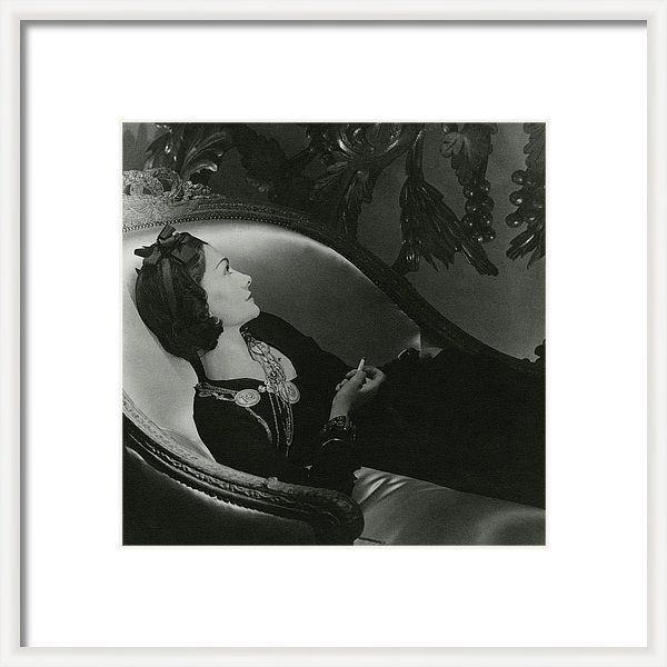 Designer Framed Print featuring the photograph Coco Chanel On A Chaise Longue by Horst P. Horst