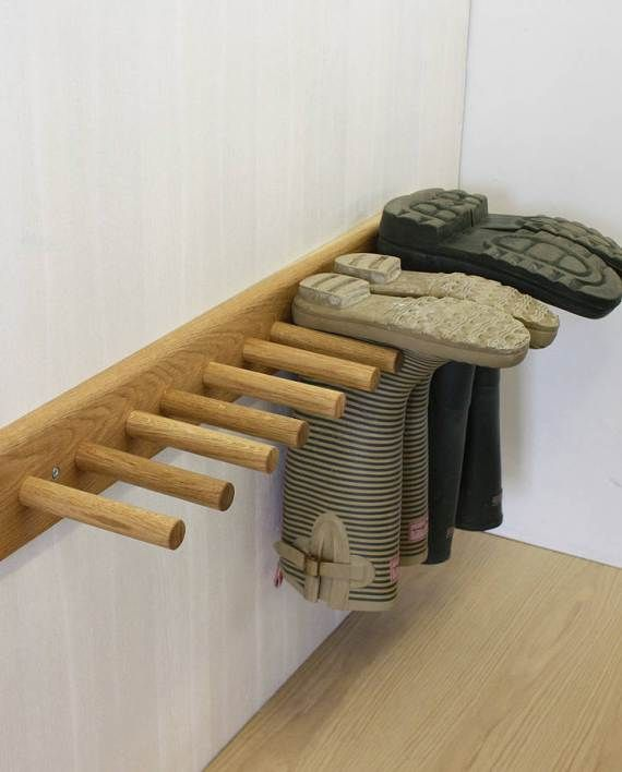 Oak Welly Rack // Keep those wellies tidy with this wall mounted oak boot rack. These handmade pegs fit every size wellington boot, from the largest member of the family to the smallest and ensure that your boots stay dry for whenever you need them.