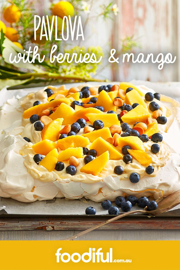 This colourful dessert is topped with summertime fruits and is a great way to use up mangoes and blueberries. This pavlova recipe has a delicious custard cream and serves 12 people. A great Australia Day party dessert, it takes 3 hours to make.
