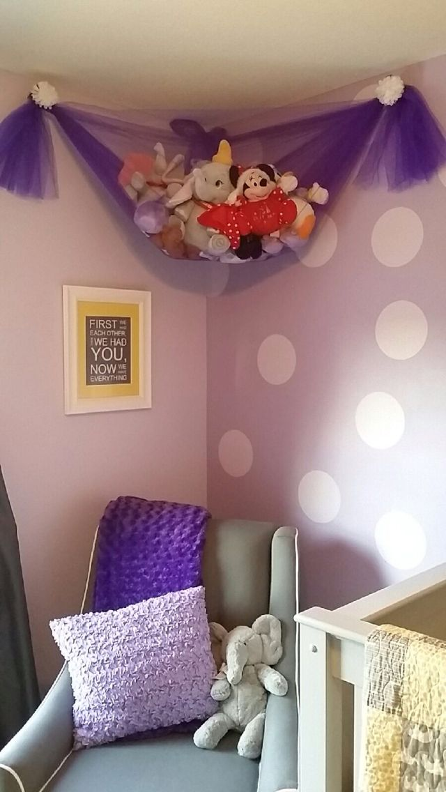 Purple and yellow nursery with tulle stuffed animal holder