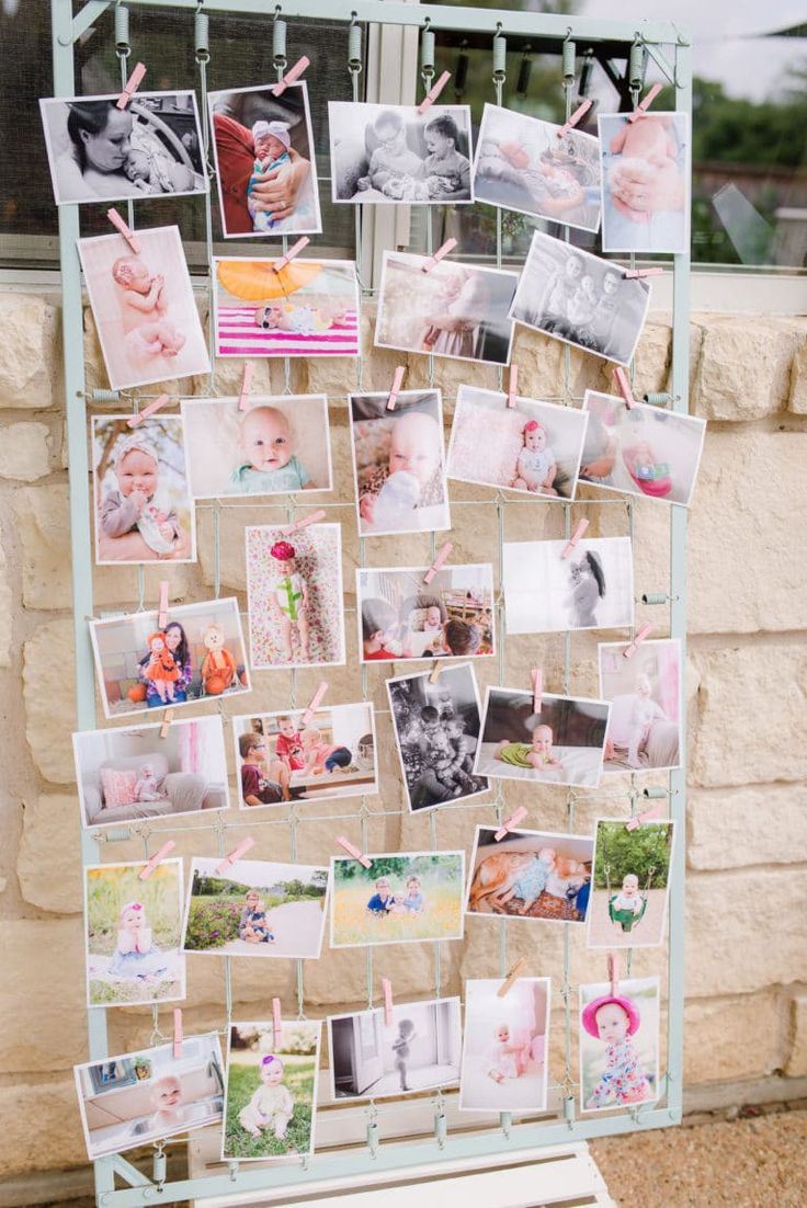 Let the guests take home their favorite picture of the birthday girl! >> DIY first birthday picture display