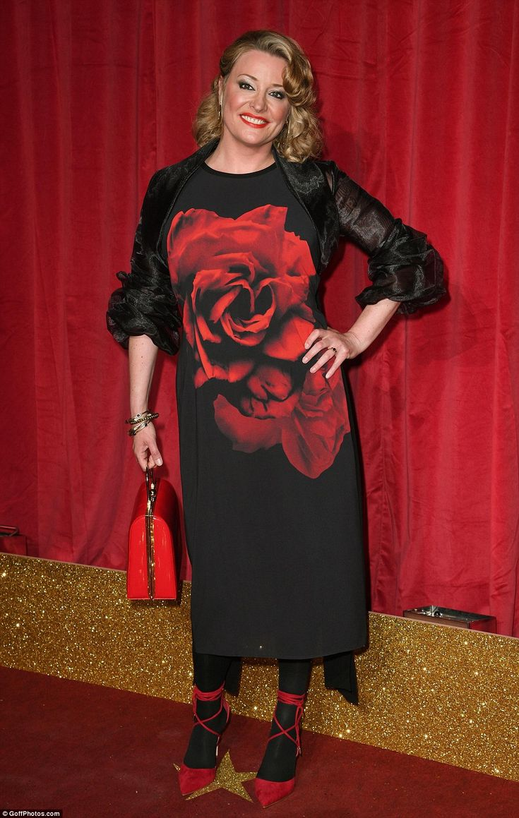 English rose: Laurie Brett's dress was emblazoned with a large red rose and she pulled off...